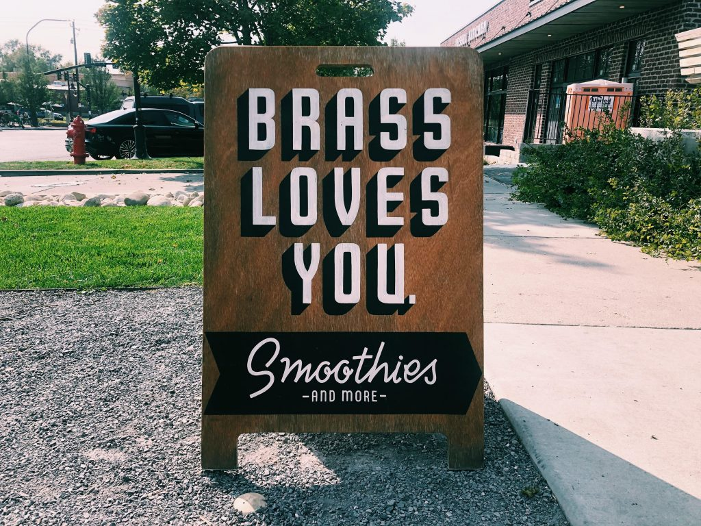 This is a photo of a sign outside Brass Smoothie.